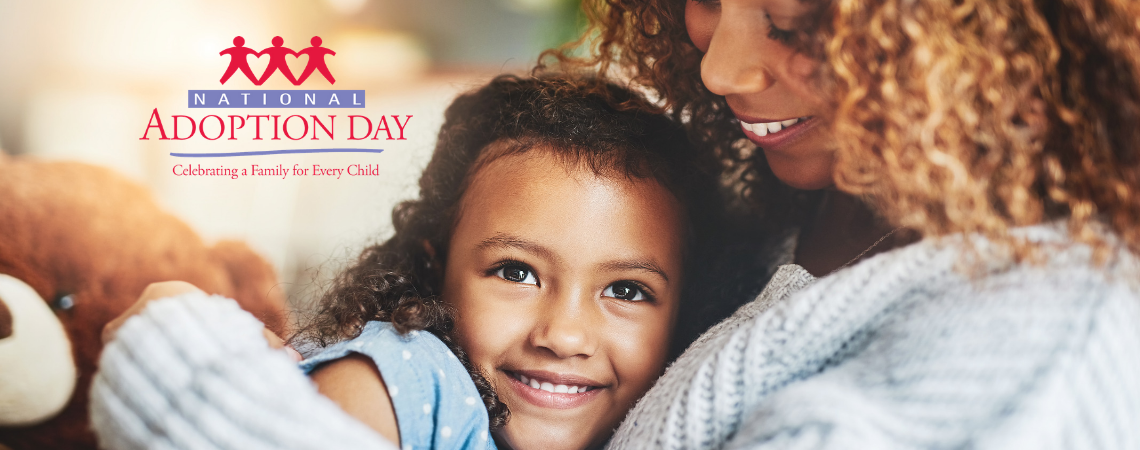 Natinonal Adoption Day graphic featuring a young girl being held by her mother